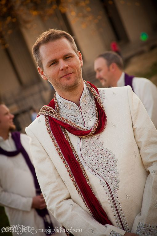 Fusion Indian wedding groom in white kurta with red dupatta via IndianWeddingSite.com