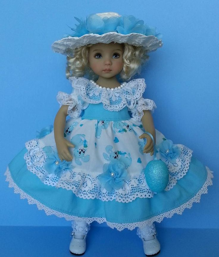 """Salstuff Bunny Dress with a lot of Lacy Petticoat, sparkle beads handstitched at neckline and handcrafted flowers around the skirt. With Hair Flower Clip & Sparkle Easter Egg. The straw hat is hand painted with white acrylic paint. For Little Darling 13"""" doll."""