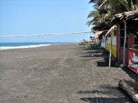 Puerto San Jose, Guatemala...for SURE not one of the cleanest beaches you'll ever see, but it has black sand!!  LOL  mostly, pretty cool to hang out with the locals and shop for cool jewelry!  :)