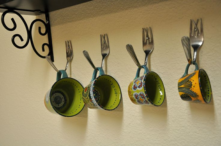 Love this clever idea to hang mugs with forks!●●●●● great idea to use for coat hangers too!