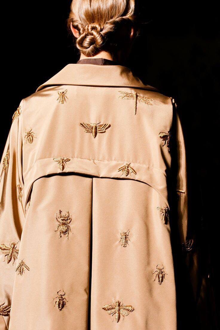 blush and gold insect coat