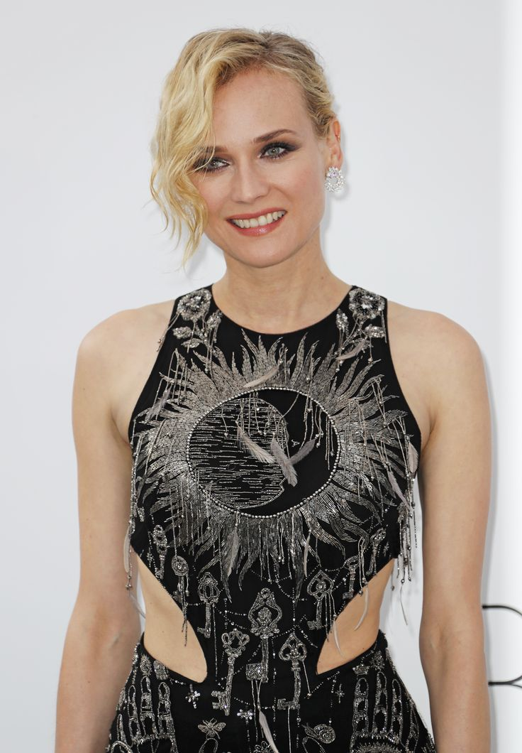 Diane Kruger wore 18 carat fair mined white gold earrings from the Chopard Green Carpet collection with her extravagant cut out black floor length gown and beading. At the amFAR Gala. For glamour celebrity fashion Cannes Film Festival red carpet jewellery spotting travel here: http://www.thejewelleryeditor.com/jewellery/top-5/cannes-film-festival-amfar-gala-2017-red-carpet-jewellery/ #jewelry