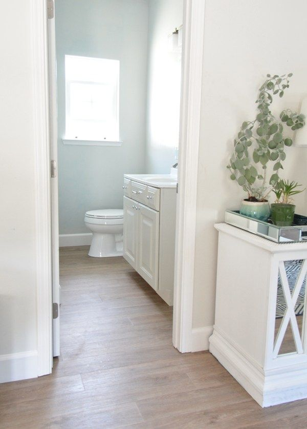 bathroom vinyl plank flooringhttp://www.flooranddecor.com/nucore-trending-laminate/nucore-driftwood-oak-plank-with-cork-back-100109750.html#