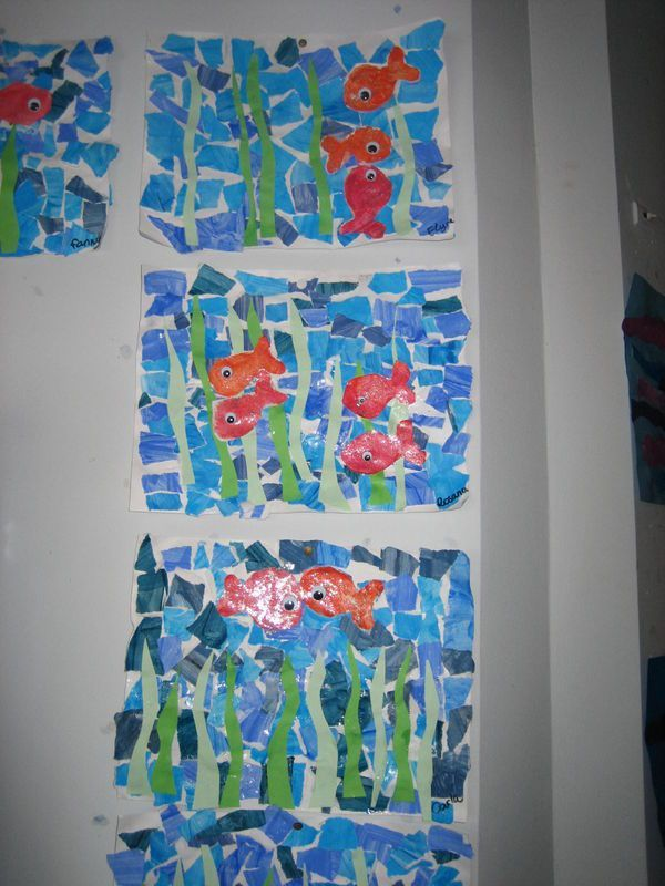 Painted paper collage/mosaic.. Everyone create a fish and the whole background be blue water.
