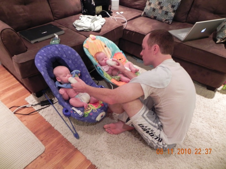 The Workmans My Hubby Bottle Feeding The Twins In Bouncy