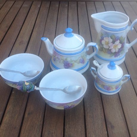 Hand painted porcelain breakfast set with third fire colors.