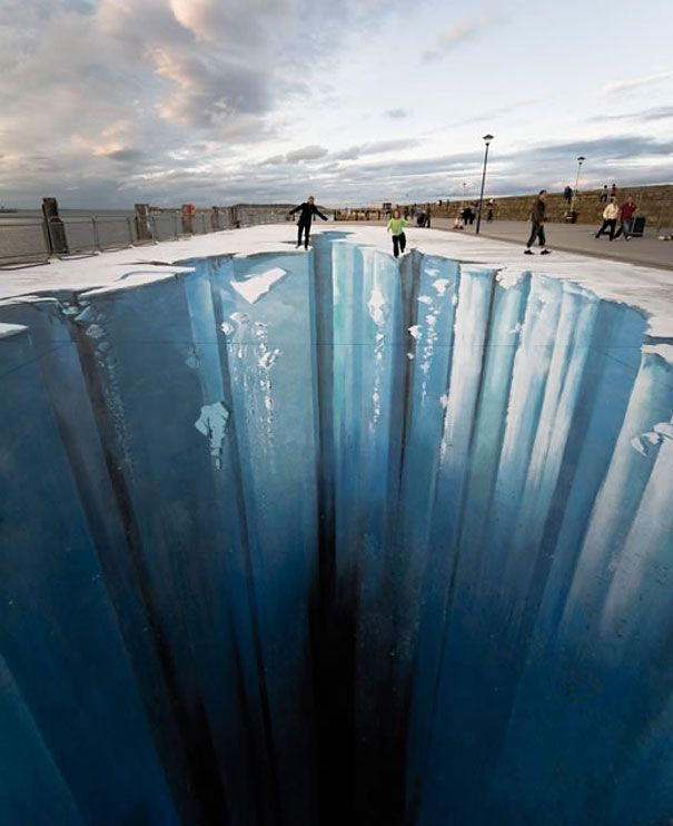 The Crevasse, a 3D image by Edgar Müller, in Dun Laoghaire, Ireland. The 250-square metre image, which took five days to paint, appears to show a fault in the earth's crust.