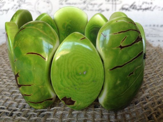 Wide cuff green statement bracelet made of Tagua nut. Unique jewelry for women, one of a kind.