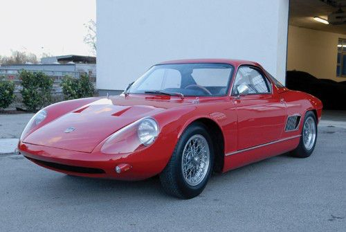 1963 ATS 2500 GTS - ATS (which stands for Automobili Turismo e Sport) introduced the 2500 GT road car in 1963 with a 220 horsepower 2.5 liter V8 mounted behind the driver but in front of the rear axle. About 12 road cars were built.