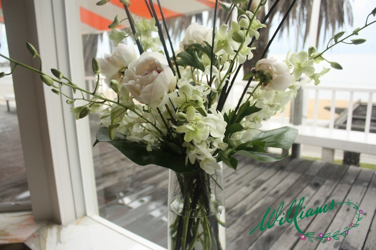 White Peony Roses, White Singapore Orchids, and Tropical Leaves.