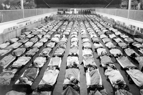 Scenes like the here—row on row of cots filled with patients stricken in the  1918 influenza epidemic—were common all across the country,