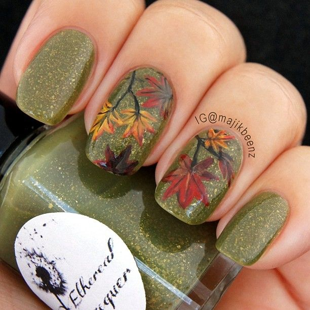 """Nails / Nailart -  Autumn leaves nail art for the Fall season. I used Ethereal Lacquer """"Enthrall"""" as my base and acrylic paints for the leaves. --- Instagram @majikbeenz"""
