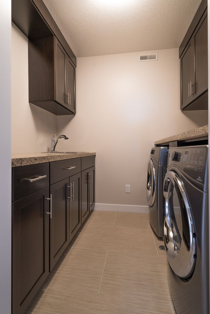 Laundry room with custom cabinets for ultimate storage!