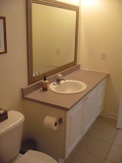 How to frame a plain bathroom mirror.