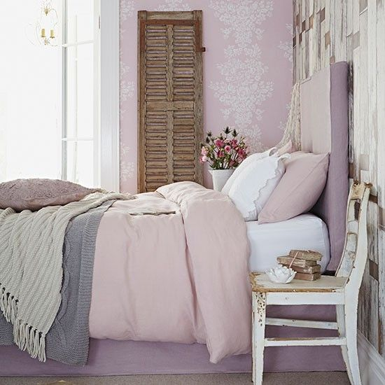 The Bedroom in the above is a very soft colored shabby chic style Bedroom; an old chair has been accommodated as the Bedside table. The Soft lilac monochromatic tones are stunning and giving the room a blissful environment. The old woods used as the door of some storage rack at the back is a very pleasing and eye catching element, some Flowers, books and patterned wallpapers are making a combination of mesmerized and joyful elements in the room.