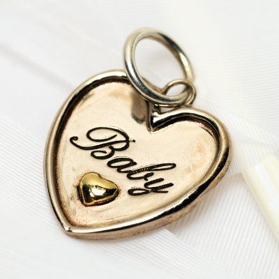 A little heart with in a heart and the simple word: Baby. Sterling Silver and Brass.