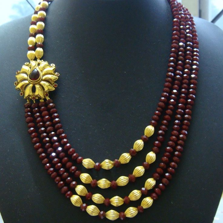 Multi strand necklace with side pendant