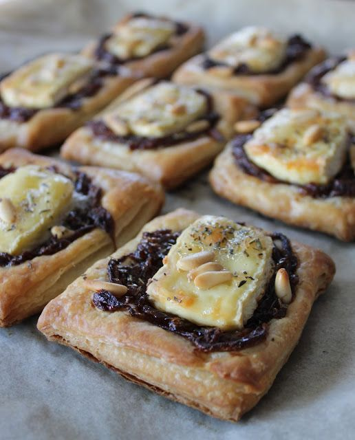 Um this is amazing. Balsamic caramelized onions, brie, puff pastry and pine nuts!!!