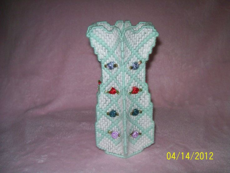 I made this vase with plastic canvas and glued on ribbon ...