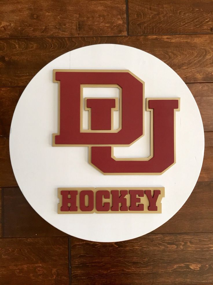 Denver university hockey logo. Denver university wall art. Hand made by kate hall. Custom woodworking.