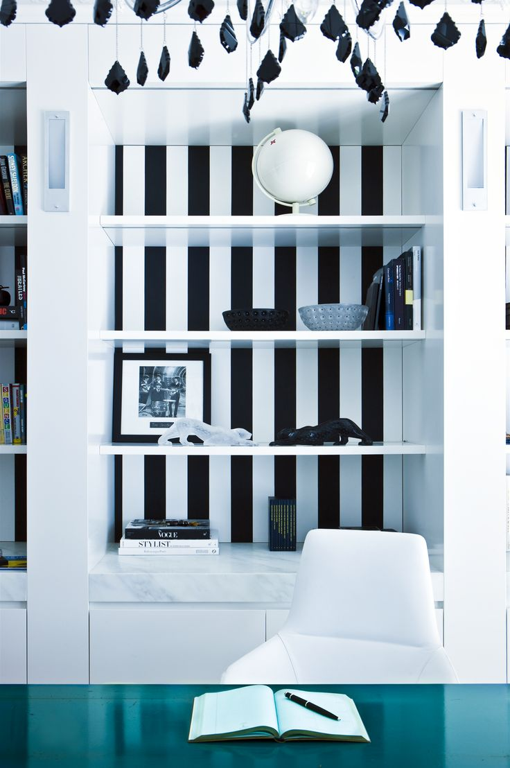 Home office with black and white stripe shelves