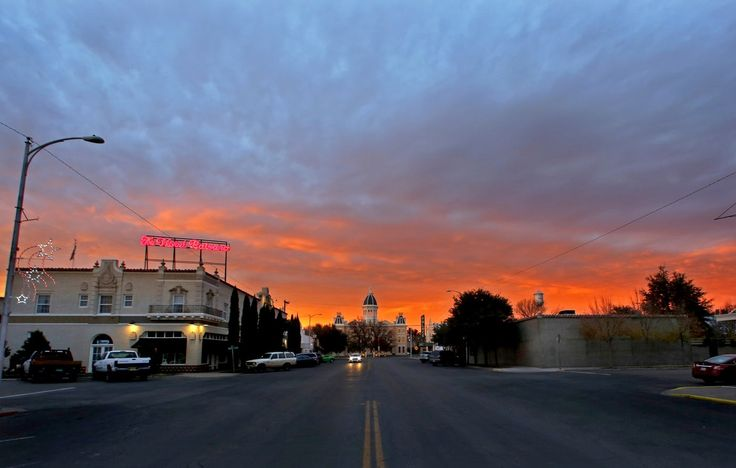 The sun sets over Hotel Paisano and the Presidio County Courthouse in Marfa, Texas. (Guy Reynolds/The Dallas Morning News)