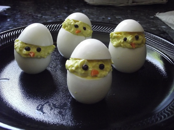 Deviled egg chicks.  Using what I saw on this website and Rachel Ray's show, I followed their directions.  I also sliced a thin layer off the bottom of the egg to help them stand up on their own.