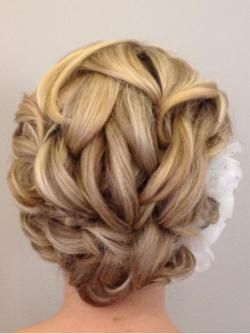MODERN Facebook fan Megan Lelonek, of Five Star Salon and Spa in Davenport, Iowa, created this beautiful bridal updo