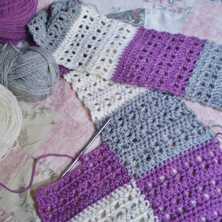 The LOVE blanket pattern by Fairysteps. Lots of photos showing you how to make the strips and how to join them as you go.