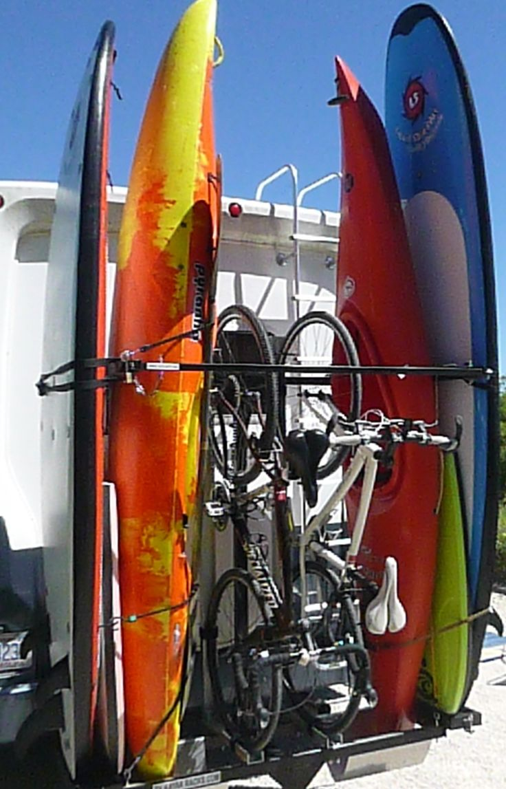 must use a DUAL HITCH RECEIVER in order to use both this rack and tow a vehicle behind your RV. http://www.rvkayakrack.com/ $299