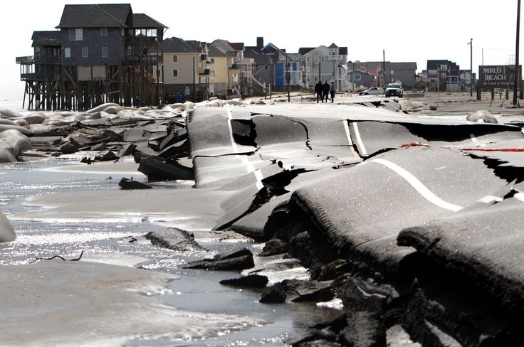 Buckled road from pounding surf in Rodanthe, N.C. on Tuesday, Oct. 30, 2012, from Hurricane Sandy. (AP Photo/The Virginian-Pilot, Steve Earley)