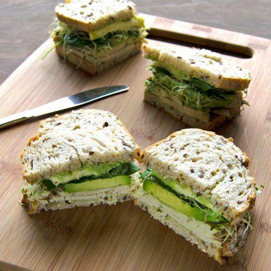 Green Goddess Roasted Turkey Sandwich - avocado, spinach, sprouts, roasted turkey, brie and green goddess dressing.
