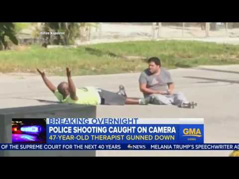 YouTube  - Police an shoots unarmed man who has his arms in the air , for no reason    -   Miami