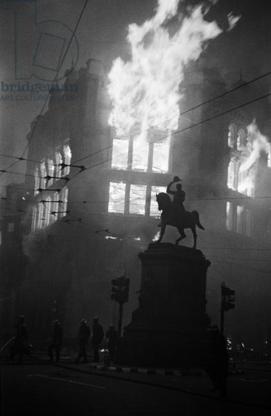Holborn Circus ablaze after an air raid, with the statue of Prince Regent in the foreground, 16th April 1941 (b/w photo)