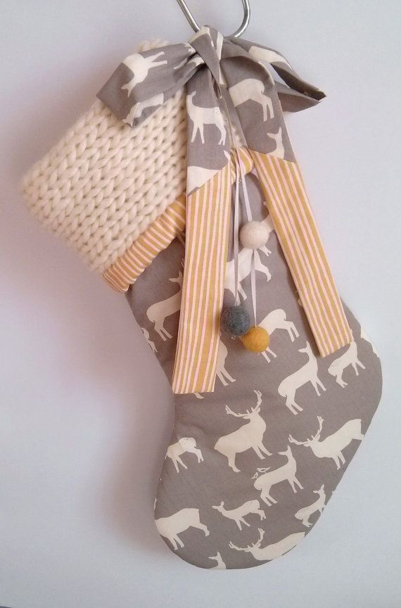 These deer stockings are new for this year! They are completely handmade from start to finish by myself, and are made from organic cotton fabric and soft wool. The stocking you will receive is the one pictured. It is grey in colour and features a small deer print. The top of the stocking has been knitted with cream wool. The stocking is gently padded and fully lined with a yellow striped fabric (organic cotton fabric again). It also features a fabric ribbon for hanging the stocking up and 4…