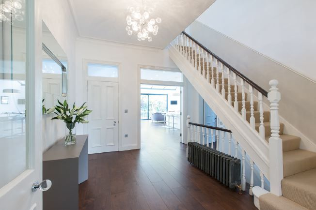Wide entrance hall stairs and landings in modernised for Hall and stairs ideas
