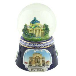 Acest glob din sticla este personalizat in interior cu macheta Ateneului Roman, o ploaie de particule stralucitoare inundand peisajul in momentul in care globul este intors.Ateneul Roman este una dintre cele mai frumoase si impozante cladiri din tara, arhitectura imbinand elemente ale stilului neoclasic cu ale celui eclectic.Baza din ceramica de un albastru cobalt, imbogatita cu imagini in relief reprezentand diverse edificii din Romania (Sala Palatului din Bucuresti, Opera din Cluj si ...