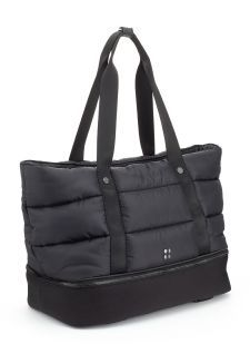 Luxe Gym Bag. The ultimate transitional bag for bootcamp to brunch, the Luxe Gym Bag has a stunning quilted aesthetic crafted from premium woven fabric that stands the test of time. The zip-open base reveals a convenient wet kit pocket, while further internal pockets secure your water bottle and valuables.