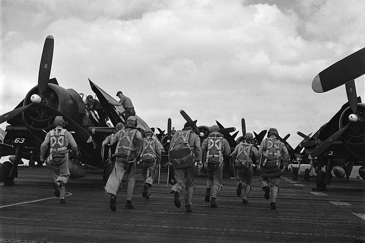 U.S. Navy pilots from fighter squadron VF-17 rushing to their Grumman F6F-5 Hellcats on the USS Hornet (CV-12), 1945.