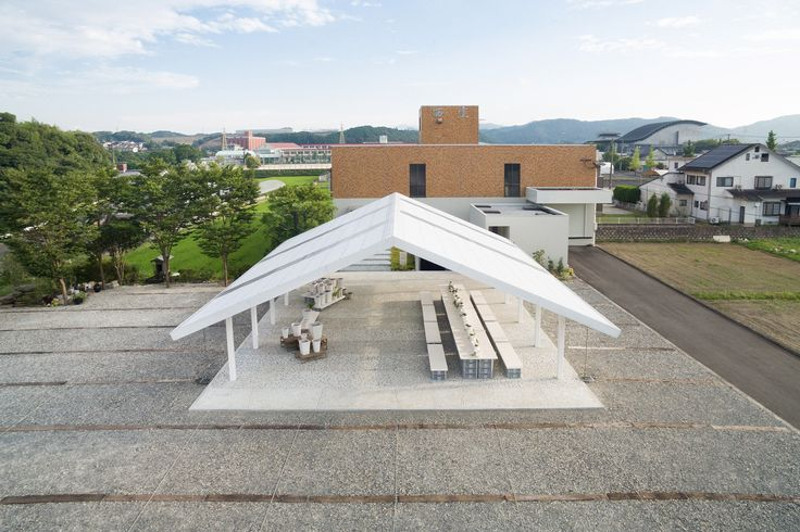 Do Do has used remnants of porcelain to update this ceramics shop and gallery in northwest Japan, and create a new pavilion for hosting workshops