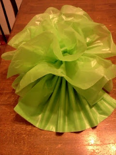 plastic tablecloth flowers, same principle but more durable than tissue paper, good for using up 'ruined' table cloths that aren't good enough for re-using but are still mostly intact.