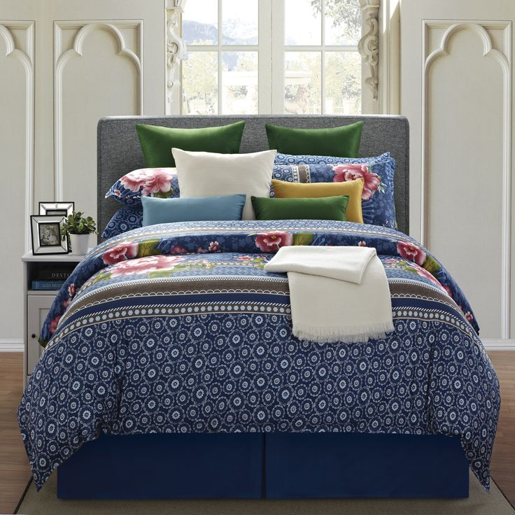 One of these eight-piece floral cotton comforter sets will add a charming touch to your bedroom. The traditional floral design is done in romantic hues of navy blue, green, and red, and its soft cotton twill material is easy to care for.