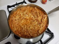 Chicken Tinga - The guy on diners driveins used guajillo chili along with the chipotle. He also caramalized his onions and just used pulled chicken from a rotisserie instead of cooking yourself. Dried mexican oregino also was added to the chicken and sauce mixture. Let simmer for at least 30 minutes for chicken to soak it up. He put it n a sopa with refried beans topped with lettuce, tomato, cheese, sour cream. Like a toasda since you can't get sopes.