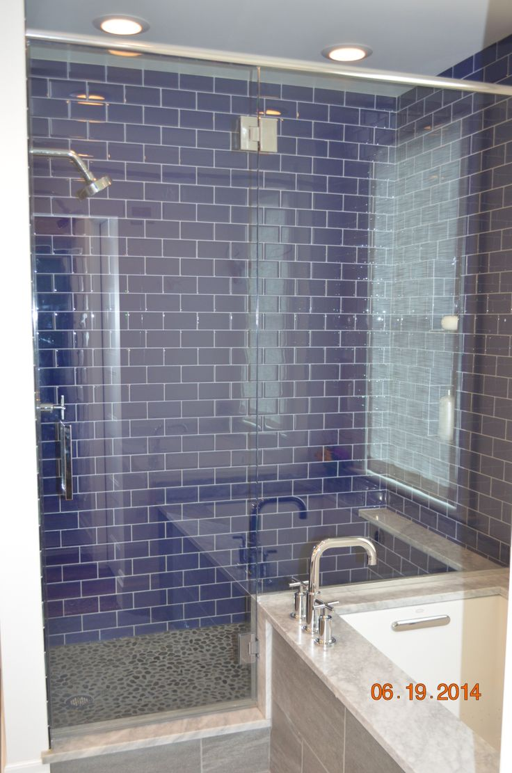 Walk In Shower With Cobalt Blue Glass Tiles.
