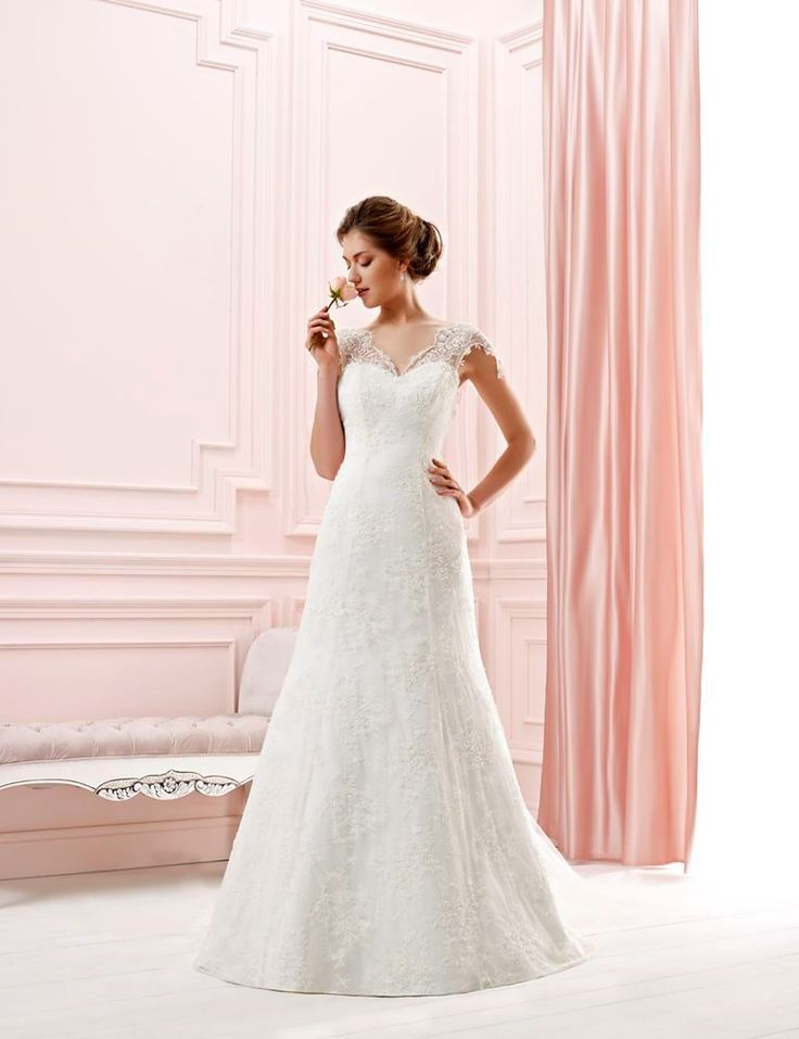 """A beautiful 2014 lace dress, called """"Deep"""". The top lace is removable. 2 dresses in 1. (As you remove lace top, you get a simple plane wedding dress.)"""