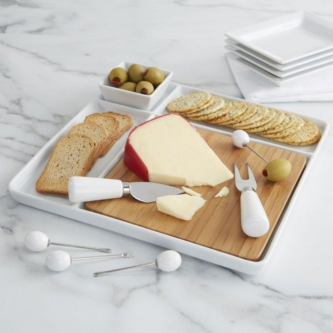 Entertain in style with our bamboo and porcelain Serve Platter. Perfect for appetizers, hors d'ouvres, cheese and crackers and any other snacks you can think of. With the included cheese knife and fork and four cocktail forks you'll be more than ready to present your guests with a variety of delicious nibbles.