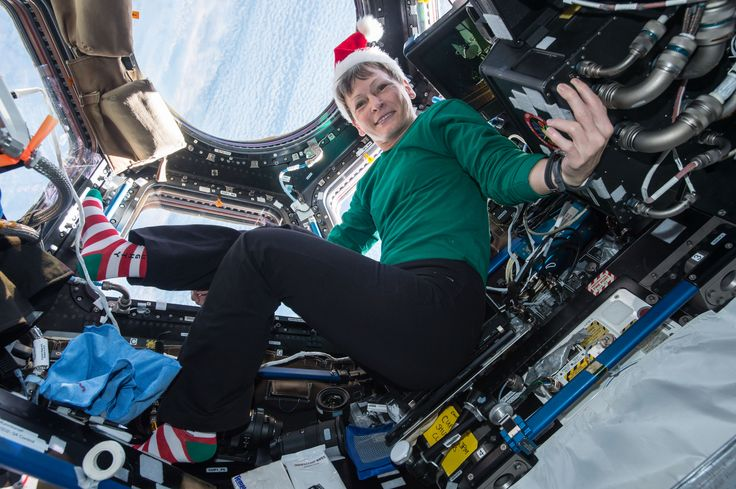 Astronaut Peggy Whitson in the Festive Spirit: Aboard the International Space Station Expedition 50 Flight Engineer Peggy Whitson of NASA sent holiday greetings and festive imagery from the cupola on Dec. 18.