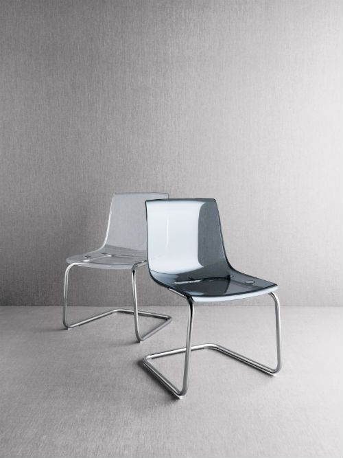 """IKEA Fan Favorite: TOBIAS chair. """"By combining glass and plastic with reflecting chrome, TOBIAS chair and TORSBY dining table become like an illusion, an abstract experience. The transparent chair feels as if it's floating in the room and the table has transparent feet that make it feel as if it's hovering above the floor."""" - Designer Carl Öjerstam"""