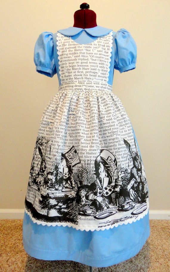 Alice in Wonderland Halloween Costume Dress by BeautifullyBecoming. Costume contains the actual script and art from the book printed on her pinafore.