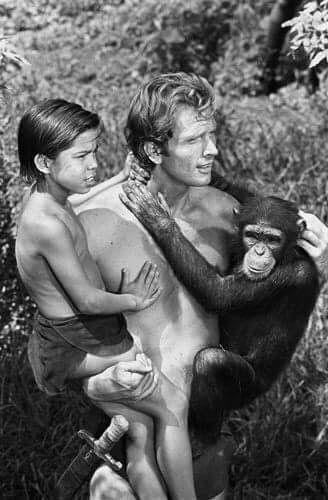 Ron Ely as Tarzan with boy and Cheetah